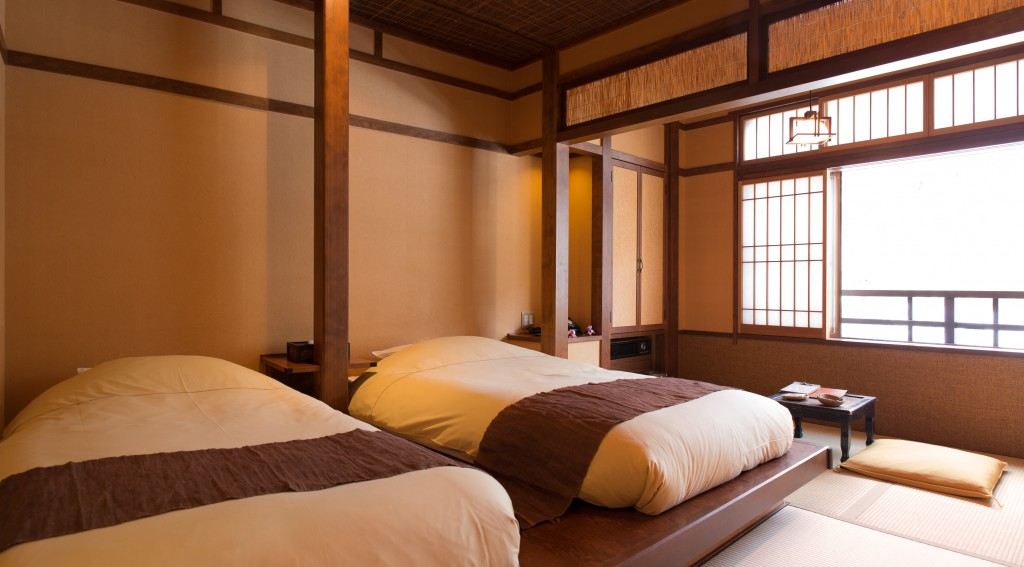 A Japanese Room With A Bed